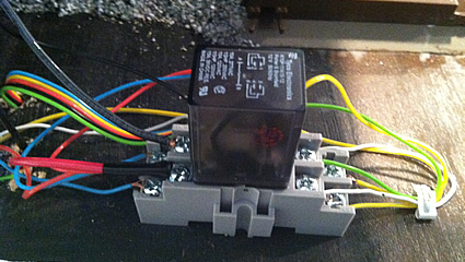 Photo of an electrical relay that operates an O scale crossing gate on the layout