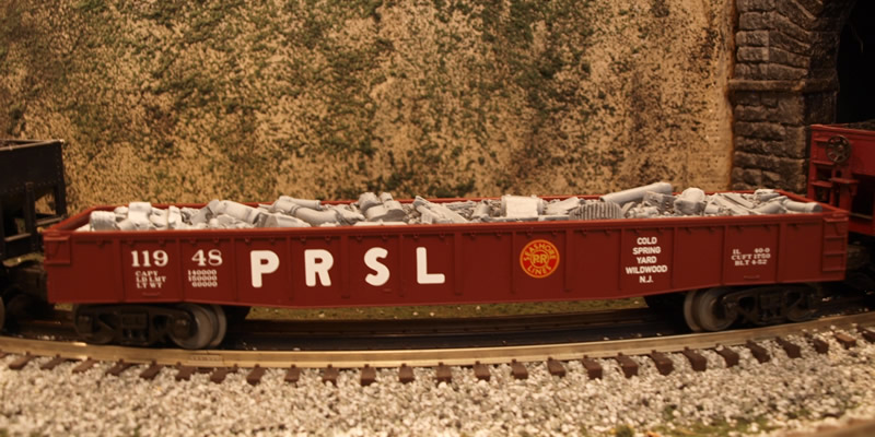 Photo of an O Gauge PRSL Gondola carrying scrap iron