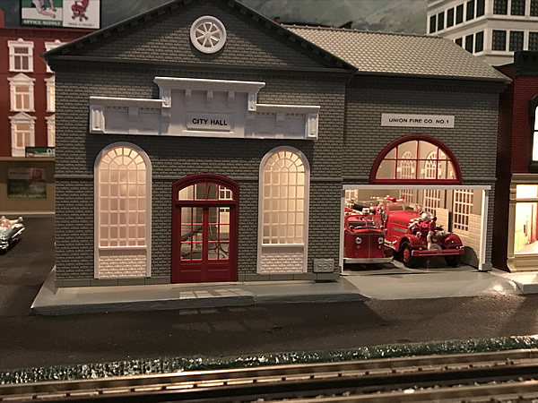 Layout photo of a model city hall and firehouse building