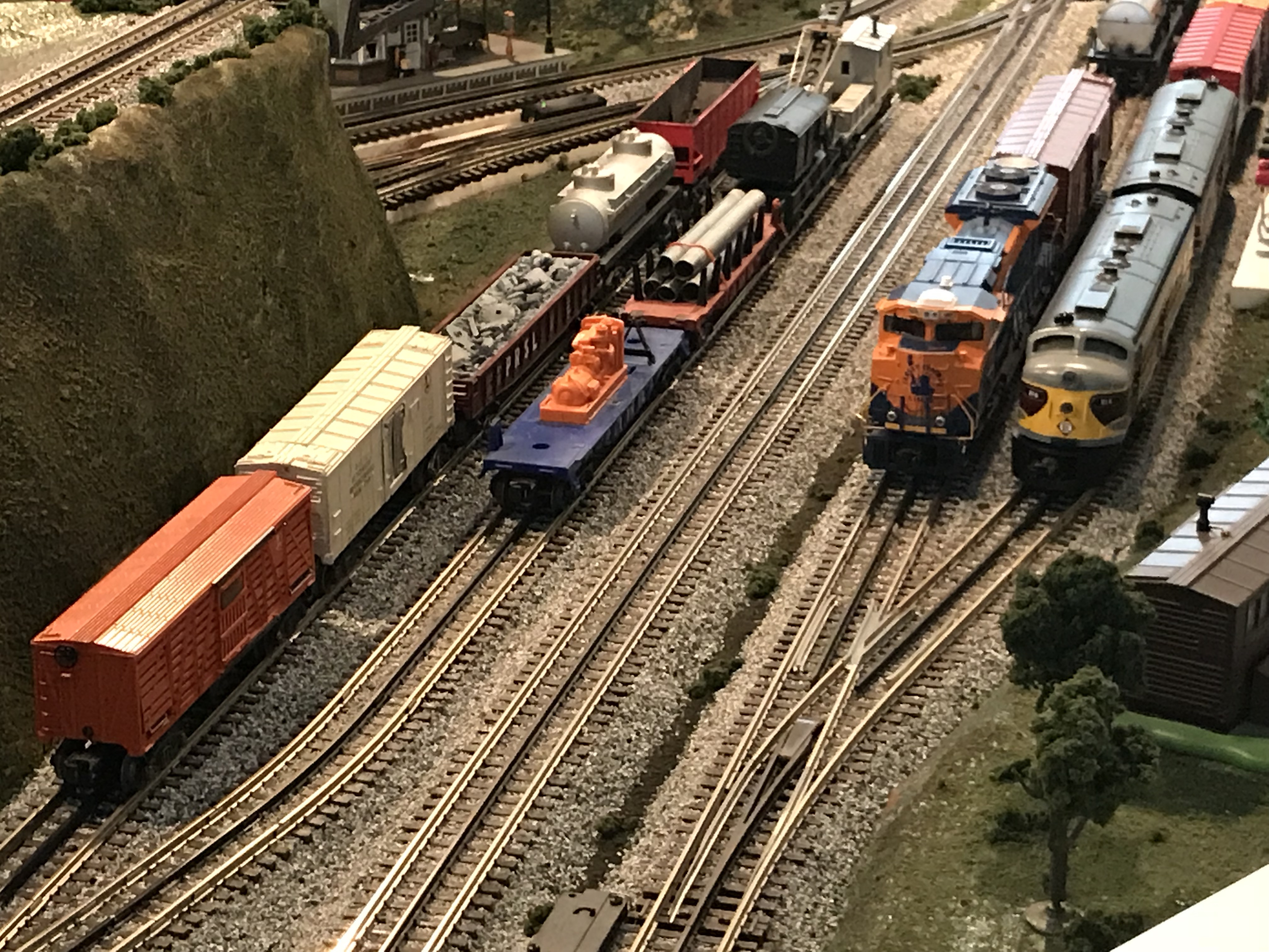 Layout photo showing the freight yard, with locomotives and freight cars in the sidings